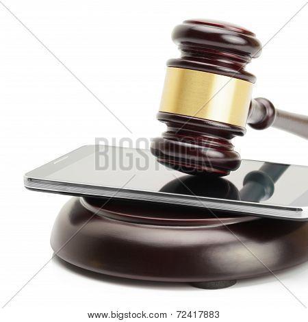 Smartphone Between Judge Gavel And Soundboard Isolated On White Background - Studio Shoot