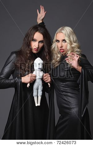 Halloween. Black and white witches and voodoo doll. Costume for Halloween Party.