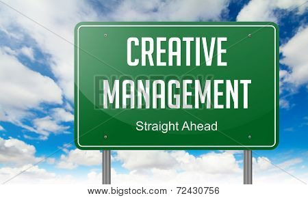 Creative Management on Highway Signpost.