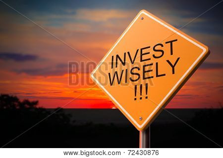 Invest Wisely on Warning Road Sign.