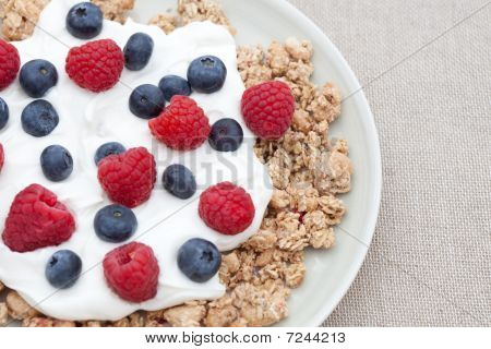 Breakfast Cereal With Fresh Raspberries, Blueberries And Yogurt