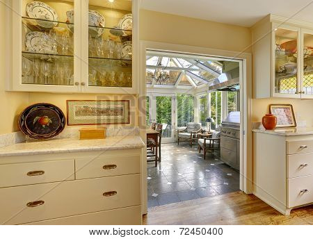 Kitchen Room With Exit To Patio Area In Sunroom