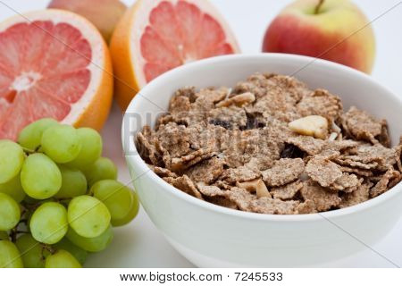 Healthy Breakfast Of Bran Flakes, Pink Grapefruit And Grapes
