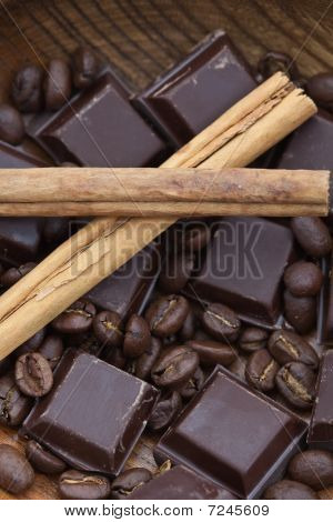 Two Cinnamon Sticks, Chocolate And Coffee Beans