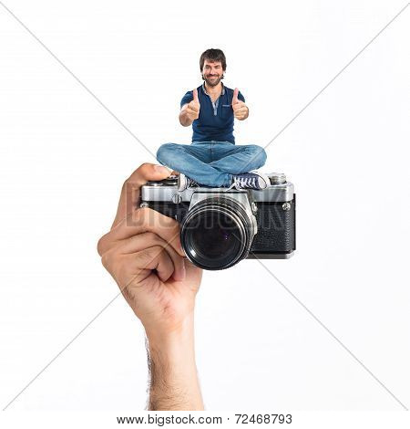 Man With Thumb Up Sitting In Camera
