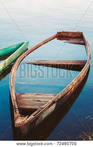 Old Sunken Wooden Fishing Boat In River. Belarusian Nature