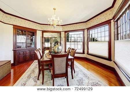Luxury Dining Room With Wood Trim And Built-in Cabinet