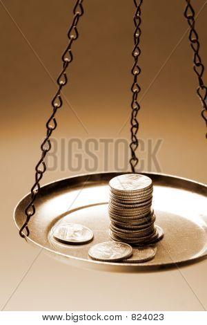 Money on a balance scale