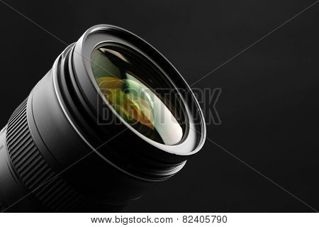 Camera lens on dark background