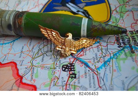 Illustrative editorial.Cockade of Ukrainian air force. Estern Ukraine map with site MH-17 flight crush as background. At January 10,2015 in Kiev, Ukraine