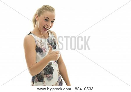 Motivated Vivacious Young Woman Giving A Thumbs Up