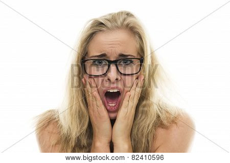 Attractive Young Woman With A Horrified Expression