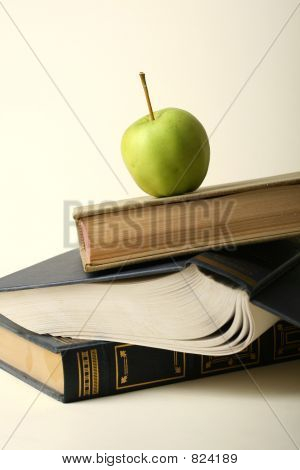 Stack of books with apple