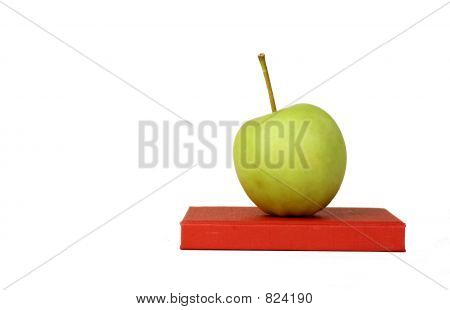 Isolated apple on book