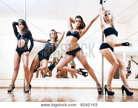 Four Young Sexy Pole Dance Women