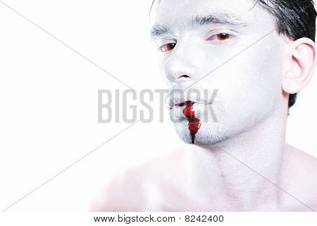 Man With Silver Makeup And Blood On Her Mouth