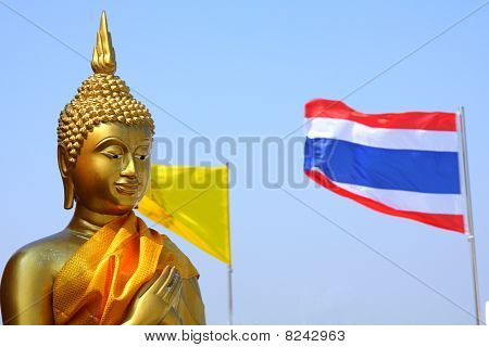 Buddha statue and flag