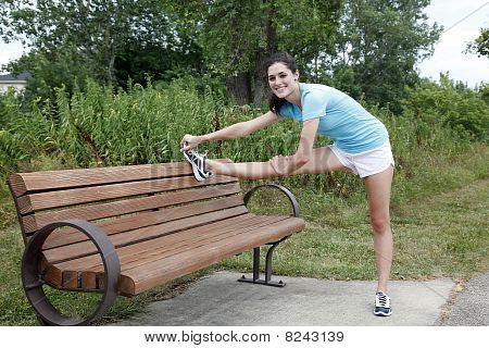 Young Woman Stretching And Smiling