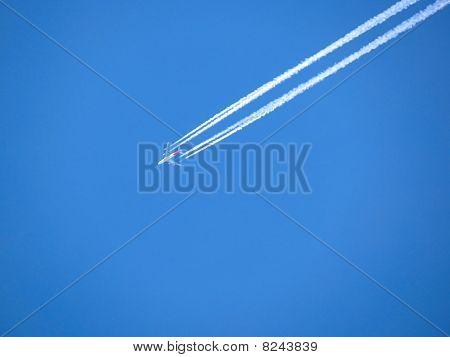 White Airplane Trace On Blue Sky