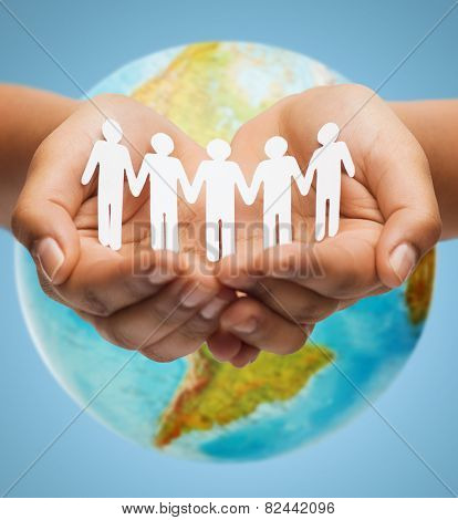 people, geography, population and peace concept - close up of human hands with earth globe showing american continent over blue background