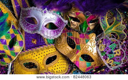 A group of venetian, mardi gras mask or disguise on a dark background poster