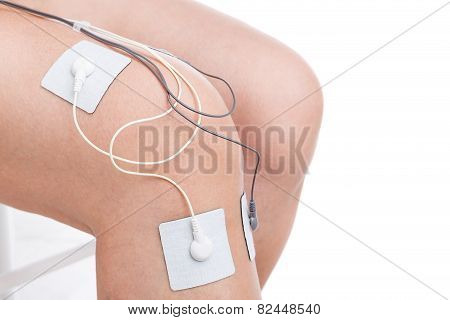 Electrostimulator Massager Treats Knee Trauma. Sports Injuries.