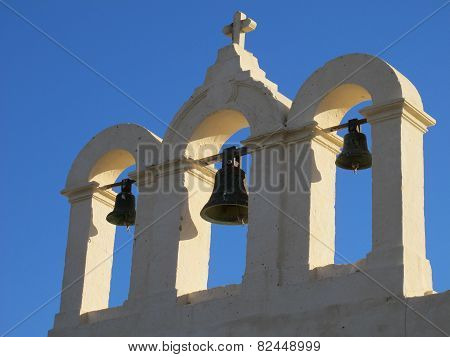 Three bells and cross on top of chapel on Comino, Malta