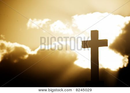 Silhouette Of A Cross In Beams Of Light