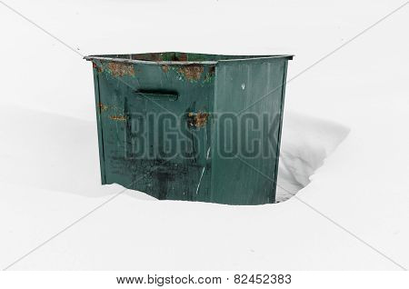 Iron Refuse Collection Waste Bin In Deep Snow.