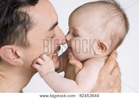 Father And Baby Daughter Sharing A Moment