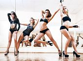 Four young sexy pole dance women. Bright white colors. poster