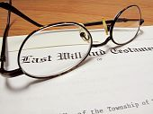 Actual last will and testament with eyeglasses on wooden desk poster