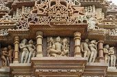 Stone carved erotic bas relief in Hindu temple in Khajuraho, India. Unesco World Heritage Site Stone carved erotic bas relief in Hindu temple in Khajuraho, India. Unesco World Heritage Site poster