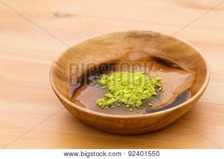 Japanese dessert with green tea and black sugar