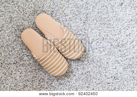 Pair of slippers on carpet