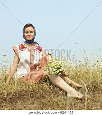Girl With Flowers  In Traditional Clothes