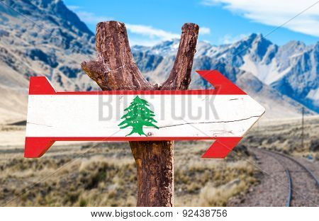 Lebanon Flag wooden sign with desert road background