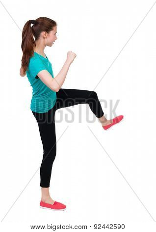 skinny woman funny fights waving his arms and legs. Rear view people collection.  backside view of person.  Isolated over white background. Sportswoman doing an intense workout.