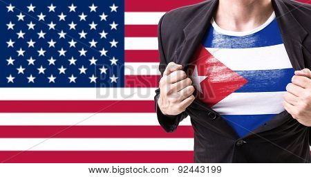 Businessman stretching suit with Cuban Flag on american flag background