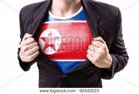Businessman stretching suit with North Korea Flag on white background