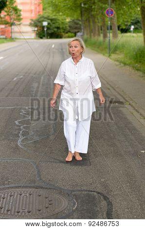 Shocked Senior Woman Walking At The Street Alone