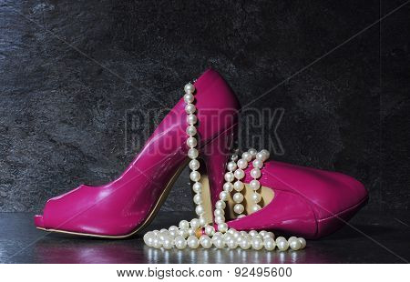 Ladies Pink High Heels With Long Strand Of White Pearls