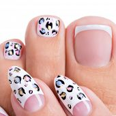 Beautiful woman's nails of hands and legs with beautiful french manicure, pedicure with art design poster
