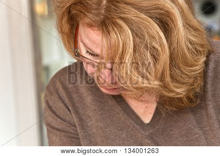 Woman With Red Hair Is Reading Newspaper