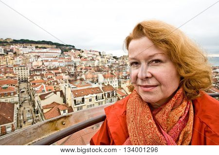 Woman Is Looking Friendly And Happy At A Scenic Point In The Old Part Of Lisbon With A Nice Overviwe