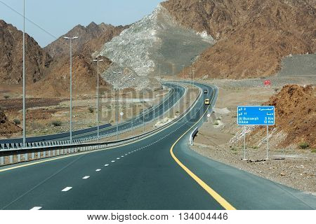 FUJAIRAH EMIRATE, UAE, 5 APRIL 2016. Photograph of Dibba-Masafi Road, Driving North to Dibba.  Roads in the United Arab Emirates are generally very well maintained and clearly signposted.