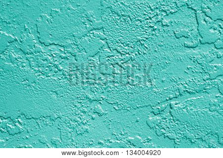 Teal or turquoise aqua green painted stucco wall texture background
