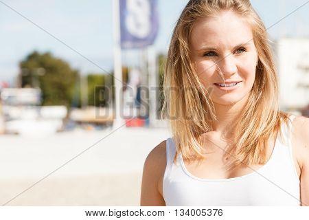 Portrait Of Beauty Woman On Marina