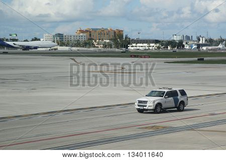 MIAMI, FLORIDA - JUNE 1, 2016:US Department of Homeland Security US Customs and Border Protection car on tarmac at Miami International Airport.