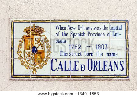 NEW ORLEANS, USA - AUG 5, 2012: old street name Calle de Orleans painted on tiles in the French quarter in New Orleans